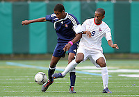 HYATTSVILLE, MD - OCTOBER 26, 2012:  Michael McCoy (9) of DeMatha Catholic High School tackles Azaan Wilbon (15) of St. Albans during a match at Heurich Field in Hyattsville, MD. on October 26. DeMatha won 2-0.