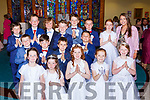 Charlene O'Connor with the pupils of Kilcummin NS at their First Holy Communion in Our Lady of Lourdes church on Saturday