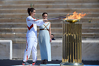 19th March 2020, Athens, Greece; The Olympic Flame, lit on Mount Olympia, is handed over officially to the  congregation from Japan, to be taken to Tokyo for the 2020 Olympic Games in July 2020. Greek athlet Katerina Stefanidi lighting the cauldron at the Panathenaic stadium, in Athens, Greece