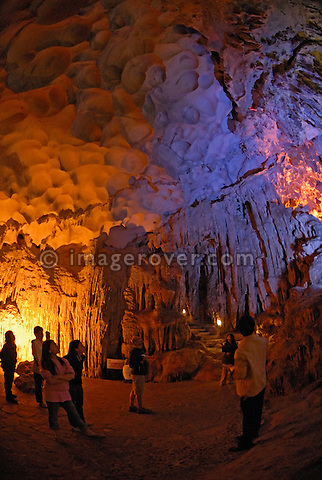 Asia, Vietnam, Halong Bay. Hang Sung Sot (Amazing Cave) within the Halong Bay. Designated a UNESCO World Heritage Site in 1994, the sensational Halong Bay is spread across 1.500 sq km, with more than 2.000 pinnacle shaped limestone and dolomite outcrops scattered across it. The impression is a labyrinthine seascape of bizarrly shaped outcrops, isolated caves, and sandy coves.