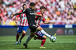 Luciano Vietto (r) of Atletico de Madrid fights for the ball with Ever Maximiliano Banega of Sevilla FC during the La Liga 2017-18 match between Atletico de Madrid and Sevilla FC at the Wanda Metropolitano on 23 September 2017 in Wanda Metropolitano, Madrid, Spain. Photo by Diego Gonzalez / Power Sport Images
