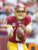 Washington Redskins quarterback Kirk Cousins (8) looks downfield as he waits for the ball in second quarter action against the Dallas Cowboys at FedEx Field in Landover, Maryland on Sunday, September 18, 2016.  The Cowboys won the game 27 - 23.<br /> Credit: Ron Sachs / CNP /MediaPunch