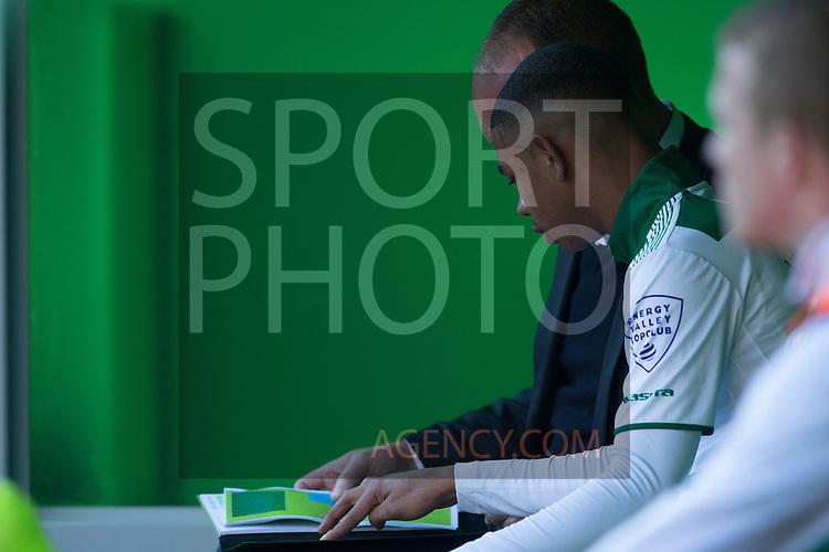 (L-R), Juninho Bacuna of FC Groningen, assistent-trainer Dick Lukkien of FC Groningen,