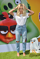 "LOS ANGELES, USA. August 10, 2019: Dove Cameron at the premiere of ""The Angry Birds Movie 2"" at the Regency Village Theatre.<br /> Picture: Paul Smith/Featureflash"