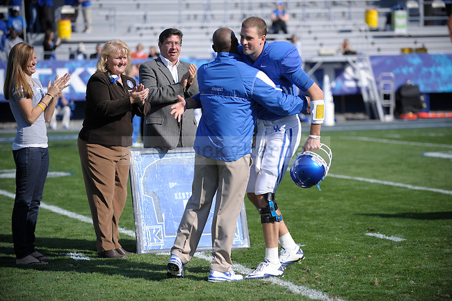Uk coach Joker Phillips hugs QB Mike Hartline for seniors day during the first half of the University of Kentucky's game against Vanderbilt  at Commonwealth Stadium in Lexington, Ky., on 11/13/10. UK won the game 38-20. Photo by Mike Weaver | Staff