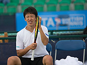 June 11th 2017, Nottingham, England; ATP Aegon Nottingham Open Tennis Tournament day 2;  Yuya Kibi of Japan checks the tension in his racket strings during his match against Roberto Quiroz of Ecuador