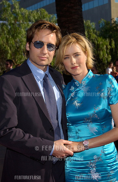 Actress TEA LEONI & actor husband DAVID DUCHOVNY at the world premiere, in Los Angeles, of her new movie Jurassic Park III..16JUL2001.  © Paul Smith/Featureflash