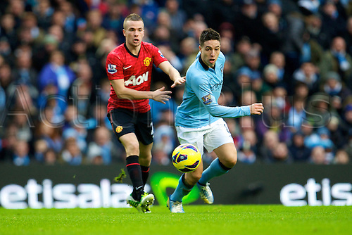 09.12.2012 Manchester, England. Manchester City's French midfielder Samir Nasri and Manchester United's English midfielder Tom Cleverley in action during the Premier League game between Manchester City and Manchester United from the Etihad Stadium. Manchester United scored a late winner to take the game 2-3.