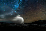 Old faithful geyser under the Milky Way, Yellowstone National Park, Wyoming, USA<br />