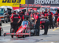 Jul 12, 2020; Clermont, Indiana, USA; Crew members for NHRA top fuel driver Billy Torrence during the E3 Spark Plugs Nationals at Lucas Oil Raceway. This is the first race back for NHRA since the start of the COVID-19 global pandemic. Mandatory Credit: Mark J. Rebilas-USA TODAY Sports