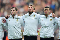 Chris Robshaw of England sings the national anthem with team-mates Elliot Daly and Jonny May. Old Mutual Wealth Series International match between England and Argentina on November 26, 2016 at Twickenham Stadium in London, England. Photo by: Patrick Khachfe / Onside Images