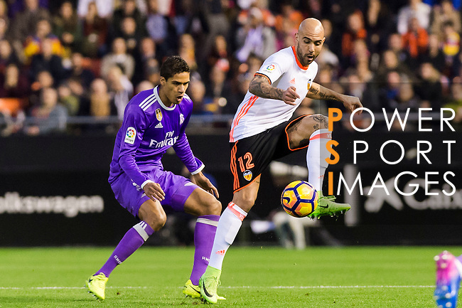 Simone Zaza (r) of Valencia CF competes for the ball with Raphael Varane of Real Madrid during their La Liga match between Valencia CF and Real Madrid at the Estadio de Mestalla on 22 February 2017 in Valencia, Spain. Photo by Maria Jose Segovia Carmona / Power Sport Images
