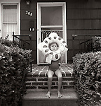 1978. Brigantine, New Jersey. Matisse with inflatable inner tube over her head.