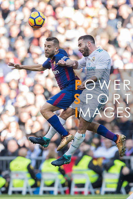Jordi Alba Ramos (L) of FC Barcelona fights for the ball with Daniel Carvajal Ramos of Real Madrid during the La Liga 2017-18 match between Real Madrid and FC Barcelona at Santiago Bernabeu Stadium on December 23 2017 in Madrid, Spain. Photo by Diego Gonzalez / Power Sport Images