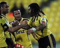 Ma'a Nonu (right) is congratulated by teammates for his try. Super 15 rugby match - Hurricanes v Lions at Westpac Stadium, Wellington, New Zealand on Saturday, 4 June 2011. Photo: Dave Lintott / lintottphoto.co.nz