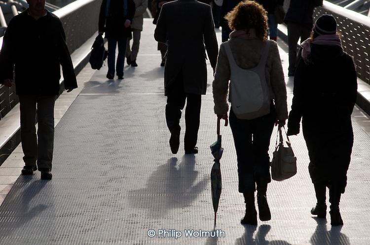 Pedestrians on the Millenium Bridge, London.