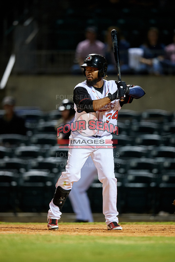 Arkansas Travelers left fielder Keury De La Cruz (34) at bat during a game against the Midland RockHounds on May 25, 2017 at Dickey-Stephens Park in Little Rock, Arkansas.  Midland defeated Arkansas 8-1.  (Mike Janes/Four Seam Images)