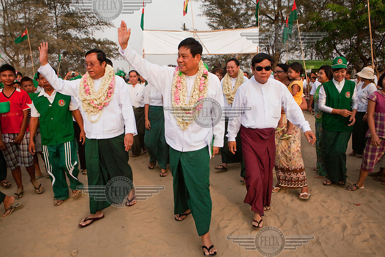 Former military General and General Secretary of the ruling government Union Solidarity and Development Party (USDP) U Htay Oo waves as he arrives at a political rally ahead of the by-elections in Yuzana.