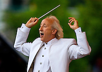 Conductor Albert-George Schram leads the Charlotte Symphony during the Summer Pops Series 2008, at SouthPark Mall.