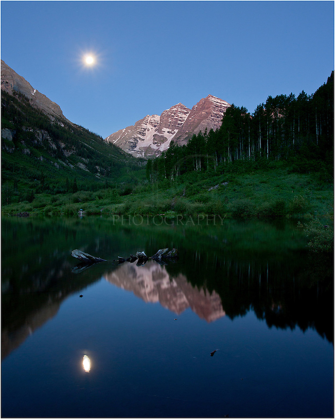 The Maroon Bells is a mystical place. This Colorado photograph comes from Maroon Lake well before sunrise as the full moon was setting in the distance. The lake was calm and I was able to take a long exposure to show off this landscape in one of Colorado's most photographed locations.