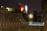 Marking 50 days to go to the Commonwealth Games Caerphilly Castle is lit up with the Team Wales flag.<br /> 23.06.14<br /> &copy;Steve Pope-SPORTINGWALES