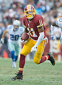 Washington Redskins wide receiver DeSean Jackson (11) carries the ball after making a catch in the third quarter against the Dallas Cowboys at FedEx Field in Landover, Maryland on Sunday, December 28, 2014.  The Cowboys won the game 44-17.<br /> Credit: Ron Sachs / CNP