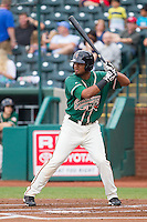 Felix Munoz (27) of the Greensboro Grasshoppers at bat against the Hagerstown Suns at NewBridge Bank Park on May 20, 2014 in Greensboro, North Carolina.  The Grasshoppers defeated the Suns 5-4. (Brian Westerholt/Four Seam Images)