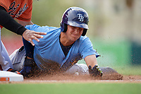 Tampa Bay Rays Josh Lowe (18) slides safely into third base as the ball is under his left leg during an Instructional League game against the Baltimore Orioles on October 2, 2017 at Ed Smith Stadium in Sarasota, Florida.  (Mike Janes/Four Seam Images)