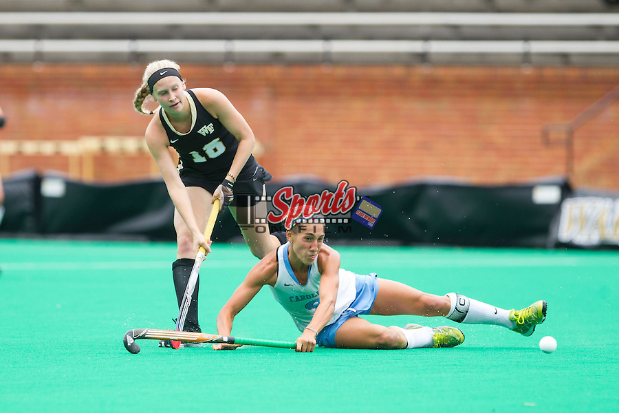Emily Conroe (18) of the Wake Forest Demon Deacons attempts to keep the ball away from Emily Wold (9) of the North Carolina Tar Heels during second half action at Kentner Stadium on October 12, 2013 in Winston-Salem, North Carolina.  The Demon Deacons defeated the Demon Deacons 4-2.  (Brian Westerholt/Sports On Film)