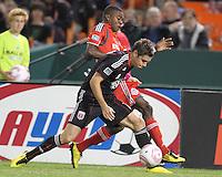 Devon McTavish #18 of D.C. United battles against Nicholas Lindsay #37 of Toronto FC during an MLS match that was the final appearance of D.C. United's Jaime Moreno at RFK Stadium, in Washington D.C. on October 23, 2010. Toronto won 3-2.