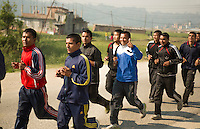 Kathmandu Nepal Local high school college running team runs down road in Nayapati Eastern Kathmandu.  42