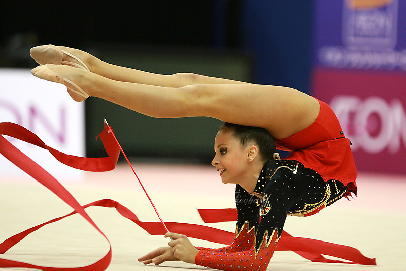 Karolina Raskina of Germany holds flexibility with ribbon at 2006 Aeon Cup Worldwide Club Championships in rhythmic gymnastics on November 16, 2006.<br />