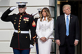 U.S. President Donald Trump stands with his wife Melania Trump, left, before greeting Benjamin Netanyahu, Israel's prime minister, not pictured, at the South Portico of the White House in Washington, D.C., U.S., on Wednesday, Feb. 15, 2017. Netanyahu is trying to recalibrate ties with Israel's top ally after eight years of high-profile clashes with former President Barack Obama, in part over Israel's policies toward the Palestinians. <br /> Credit: Andrew Harrer / Pool via CNP