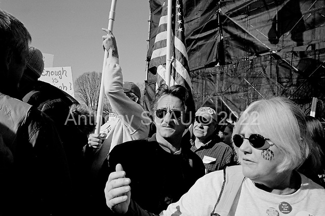 "Washington DC.District of Columbia.USA.January 27, 2007..US Actor Sean Penn watches behind the stage as he attends an anti-war demonstration on the National Mall in Washington DC. Tens of thousands massed to demand that Congress cut off funds for the Iraq war. He later addressed the crowd...Actor Sean Penn said lawmakers will pay a price in the 2008 elections if they do not take firmer action than to pass a nonbinding resolution against the war, the course Congress is now taking. ""If they don't stand up and make a resolution as binding as the death toll, we're not going to be behind those politicians,"" he said. ...."
