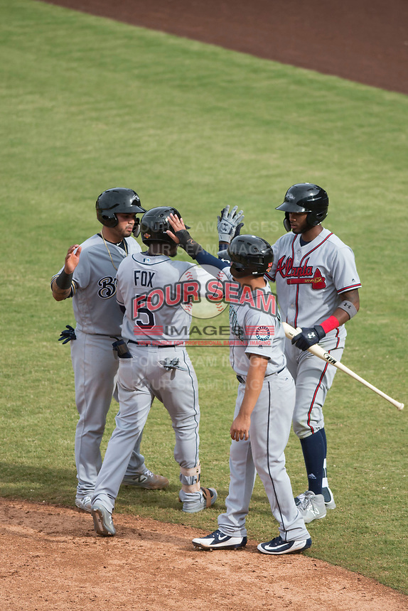 Peoria Javelinas teammates Mario Feliciano (6), Chris Mariscal (19), and Izzy Wilson (7) congratulate Lucius Fox (5), of the Tampa Bay Rays organization, after he hit a home run during an Arizona Fall League game against the Mesa Solar Sox on October 11, 2018 at Sloan Park in Mesa, Arizona. The Solar Sox defeated the Javelinas 10-9. (Zachary Lucy/Four Seam Images)