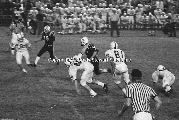 Bethel Park PA:  Offensive play with Mike Fassinger 83 running dive through the Colts secondary. Others in the photo; John Bender 19.   The Bethel Park defense played very well in the 13-6 win at Chartiers Valley Stadium. The game went down to the last play of the game when Mike Stewart threw a 65 TD pass to Gary Biro 81.  The defensive unit was one of the best in Bethel Park history only allowing a little over 7 points a game.