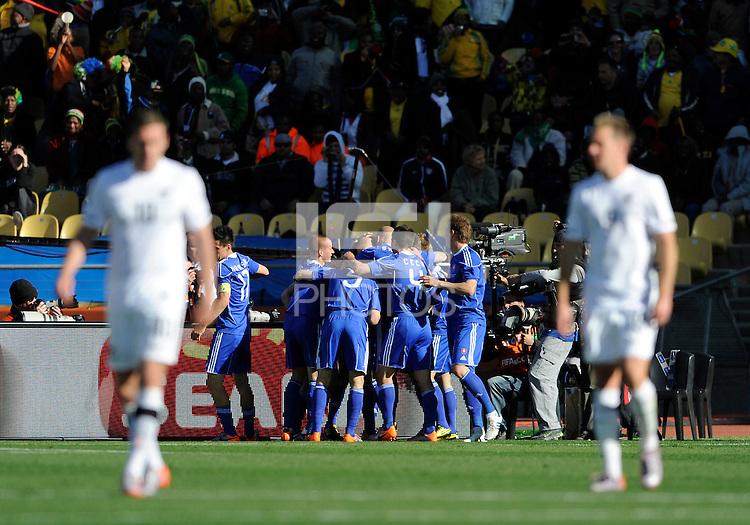 Robert Vittek of Slovakia celebrates his goal with team mates