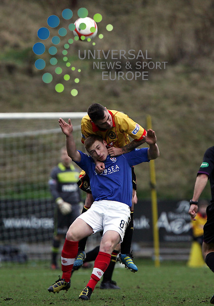Partick Thistle v Cowdenbeath.Irn Bru 1st Division.Saturday 26th Jan 2013.Firhill Stadium -- Score 2-1.Paul Paton gets the better of Liam Caddis.Photo by Tommy Taylor Universal News and Sport