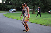 First Lady Michelle Obama walks with her daughter Malia, Sunday, August 29, 2010 upon their return to the White House in Washington, DC.  The First Family completed their 10-day vacation on Martha's Vineyard and spent Sunday in Louisiana..Credit: Olivier Douliery / Pool via CNP