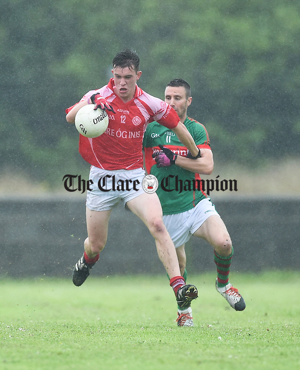 Conal O hAinifein of Eire Og in action against Shane Hickey of Kilmurry Ibrickane during their game at Labasheeda. Photograph by John Kelly.