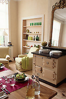 Fitting snugly into the black marble fireplace, a 50-year old Aga dominates the kitchen/living area