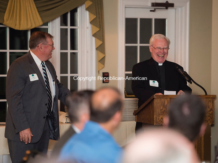 WATERTOWN, CT- 22 October 2015-102215EC08-  Paul Jessell, the President of the Watertown Foundation, shares a laugh with Father John Cooney Thursday night after a blessing. The organization's annual meeting was held at the Watertown Golf Club. Astronaut Rick Mastracchio was in the audience to give a speech. Erin Covey Republican-American