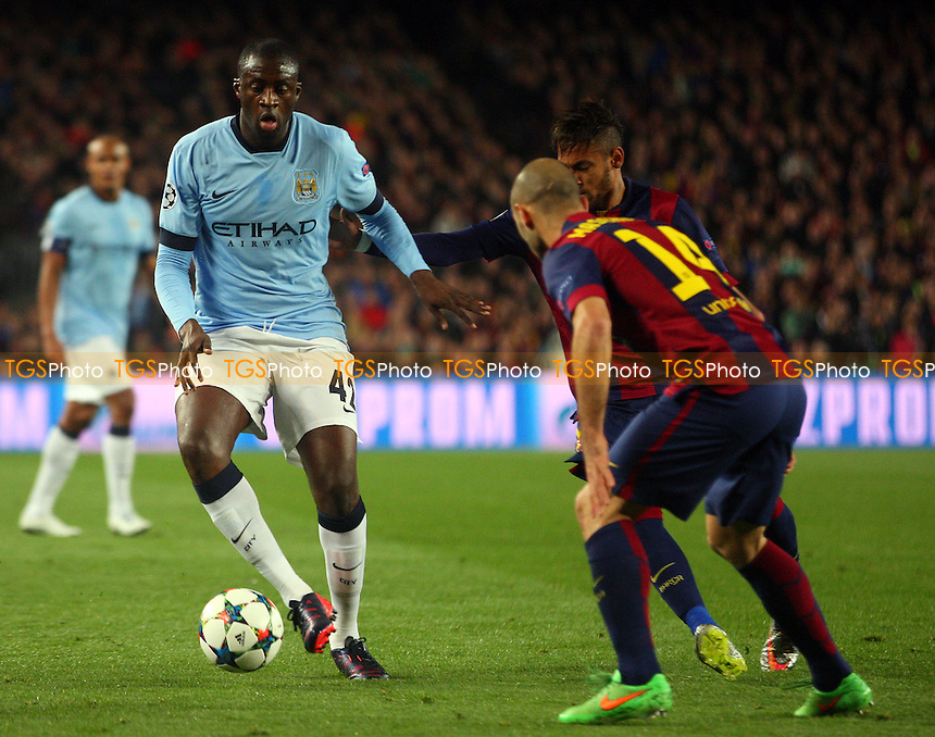/Javier Mascherano of FC Barcelona and Yaya Toure of Manchester City - FC Barcelona vs Manchester City - European Champions League Round of Sixteen Football at the Camp Nou Stadium on  18/03/15 - MANDATORY CREDIT: Dave Simpson/TGSPHOTO - Self billing applies where appropriate - 0845 094 6026 - contact@tgsphoto.co.uk - NO UNPAID USE