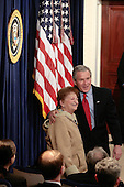 "US President Bush poses for a photo with Rose Lazear, mother of Edward ""Eddie"" Lazear who was just sworn in as Chairman of the Council of Economic Advisors at the EEOB in Washington DC March 6, 2006. Lazear's wife Vicki holds bible, and daughter Julia ""Julie"" stand with Lazear. <br /> Credit: Ken Cedeno / Pool via CNP"