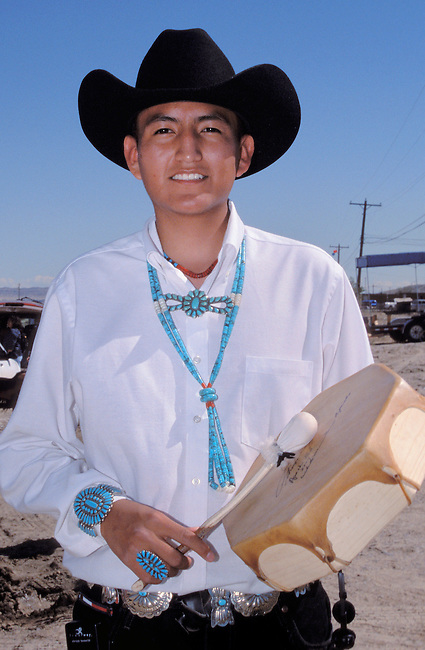 Navajo teenager is the head drummer for the youth group called Naatsiilio (Rainbow) Dancers during a festivity in Shiprock NM