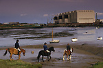Barrow in Furness Cumbria  Children riding out on their ponies VSEL Shipyard in distance, known as Maggies Shed. ( After Margaret Thatcher )
