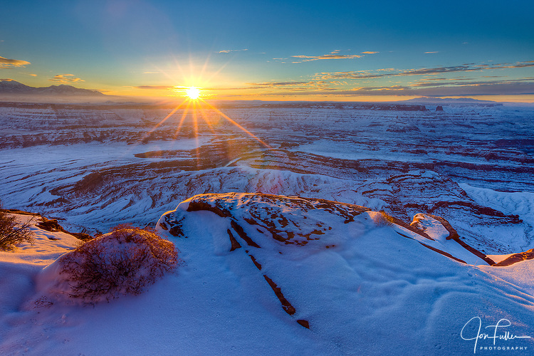 Snowy Winter Sunrise at Dead Horse Point State Park near Moab, Utah, with the La Sal Mountains (l) and the Abajo Mountains (r) in the background.