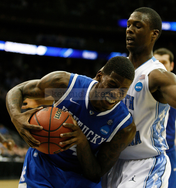 DeAndre Liggins gets the rebound in Elite 8 game against UNC of the 2011 NCAA Basketball Tournament, at the Prudential Center, in Newark, NJ.  Photo by Latara Appleby | Staff
