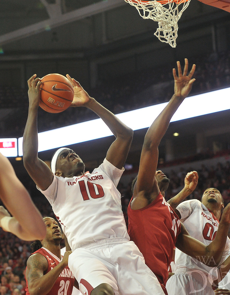 NWA Democrat-Gazette/Michael Woods --01/06/2015--w@NWAMICHAELW... University of Arkansas forward Bobby Portis tries to drive to the hoop against the Alabama defense during the first half of Thursday nights game at Bud Walton Arena in Fayetteville.
