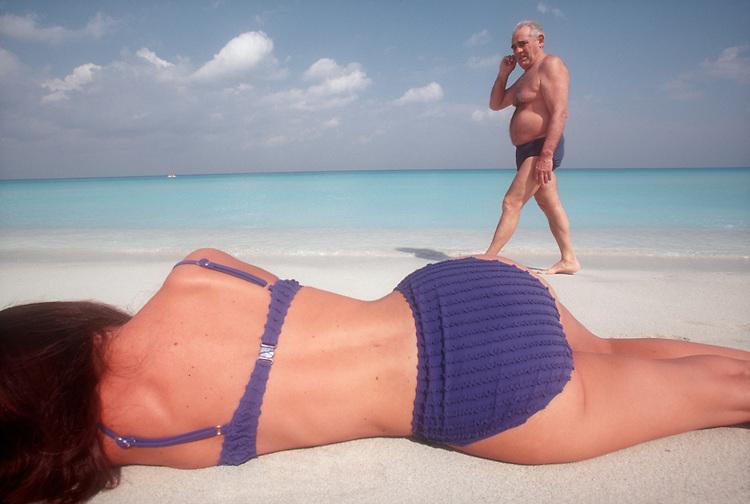 Cuba, Varadero: Man meets woman or should I say age meets reality, male ego on the great beach at Varadero, Caribbean Sea,